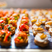 Rows of delicious canapes placed on a tray